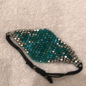 Silver and turquoise colored cuff bracelet
